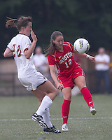 Boston University midfielder Jessica Luscinski (12) passes the ball as Boston College midfielder Zoe Lombard (20) defends. After 2 complete overtime periods, Boston College tied Boston University, 1-1, after 2 overtime periods at Newton Soccer Field, August 19, 2011.