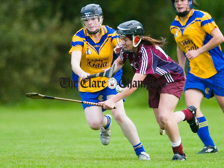 Clare's Kate Lynch moves in on Galway's Jessica Gill during the U-18 championship game in Killanena. Photograph by John Kelly.