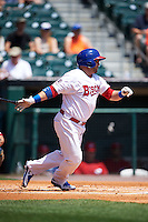 Buffalo Bisons outfielder Caleb Gindl (15) base hit during a game against the Columbus Clippers on July 19, 2015 at Coca-Cola Field in Buffalo, New York.  Buffalo defeated Columbus 4-3 in twelve innings.  (Mike Janes/Four Seam Images)