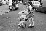 Young girl with baby sister returning from shopping trip Portobello Road, Notting Hill west London UK 1975