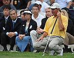 Feb 22, 2009: Fred Couples surveys his final put on hole 18 as former governor of California Gray Davis looks on at the Northern Trust Open 2009 in the Pacific Palisades, California.