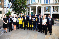 Photo: Richard Lane/Richard Lane Photography. London Wasps reception at the Central London offices of the Club's Official Main Sponsor, CVS, the business rates specialist. 02/09/2013. Wasps players, Joe Launchbury and Chris Bell with the team from CVS.