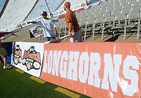 07 October 2006: Cotton Bowl employees work to place team banners around the field before the University of Texas Longhorns game against the University of Oklahoma Sooners at the Cotton Bowl in Dallas, TX.