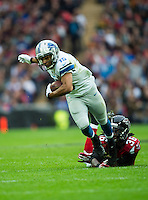 26.10.2014.  London, England.  NFL International Series. Atlanta Falcons versus Detroit Lions. Lions' WR Golden Tate [15] is tackled by Falcons' RB Antone Smith [35]