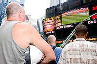 United States fans watch their team during a World Cup match against Ghana on June 22, 2006 on a large outdoor Jumbo Tron at Times Square in New York City.<br /> <br /> The World Cup, held every four years in different locales, is the world's pre-eminent sports tournament in the world's most popular sport, soccer (or football, as most of the world calls it).  Qualification for the World Cup is open to any country with a national team accredited by FIFA, world soccer's governing body. The first World Cup, organized by FIFA in response to the popularity of the first Olympic Games' soccer tournaments, was held in 1930 in Uruguay and was participated in by 13 nations.    <br /> <br /> As of 2010 there are 208 such teams.  The final field of the World Cup is narrowed down to 32 national teams in the three years preceding the tournament, with each region of the world allotted a specific number of spots.  <br /> <br /> The World Cup is the most widely regularly watched event in the world, with soccer teams being a source of national pride.  In most nations, the whole country is at a standstill when their team is playing in the tournament, everyone's eyes glued to their televisions or their ears to the radio, to see if their team will prevail.  While the United States in general is a conspicuous exception to the grip of World Cup fever there is one city that is a rather large exception to that rule.  In New York City, the most diverse city in a nation of immigrants, the melting pot that is America is on full display as fans of all nations gather in all possible venues to watch their teams and celebrate where they have come from.