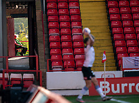 24th April 2021, Oakwell Stadium, Barnsley, Yorkshire, England; English Football League Championship Football, Barnsley FC versus Rotherham United; A Steward watches play through the corridors at Oakwell