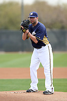 Shaun Marcum #18 of the Milwaukee Brewers participates in pitchers fielding practice during spring training workouts at the Brewers complex on February 18, 2011  in Phoenix, Arizona. .Photo by Bill Mitchell / Four Seam Images.