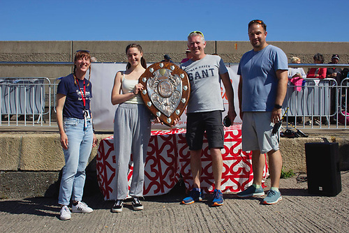 Jessica Robson centre, first Woman in the Pickie to Pier race with Gary Robinson, first Man and (left) Caroline McCoubrey Seaside Revival Co-ordinator and (right) Alan Whyte, Ballyholme YC