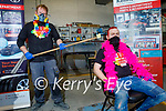 Liam Murphy with pink dye on his hair getting a hair cut from Mikey Greaney in Kellihers Garage for their Comfort for Chemo and Recovery Haven fundraiser on Friday
