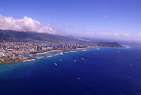 Aerial view of Ala Moana, Waikiki and Diamond Head, with Kewalo Basin, and blue ocean in foreground
