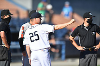 Home plate umpire Adam Clark, Aberdeen IronBirds manager Kyle Moore, Asheville Tourists manager Nate Shaver (25) and umpire Clay Williams go over lineups on June 15, 2021 at McCormick Field in Asheville, NC. (Tony Farlow/Four Seam Images)