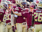 Florida State head coach Jimbo Fisher steps signals during a time out in the second half of an NCAA college football game against Syracuse in Tallahassee, Fla., Saturday, Oct. 31.  Florida State defeated Syracuse 45-21. (AP Photo/Mark Wallheiser)