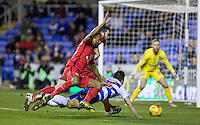 Grant Hanley of Blackburn Rovers and Lee Williamson of Blackburn Rovers appear tp push Lucas Piazon of Reading in the penalty area during the Sky Bet Championship match between Reading and Blackburn Rovers at the Madejski Stadium, Reading, England on 20 December 2015. Photo by Andy Rowland / PRiME Media Images