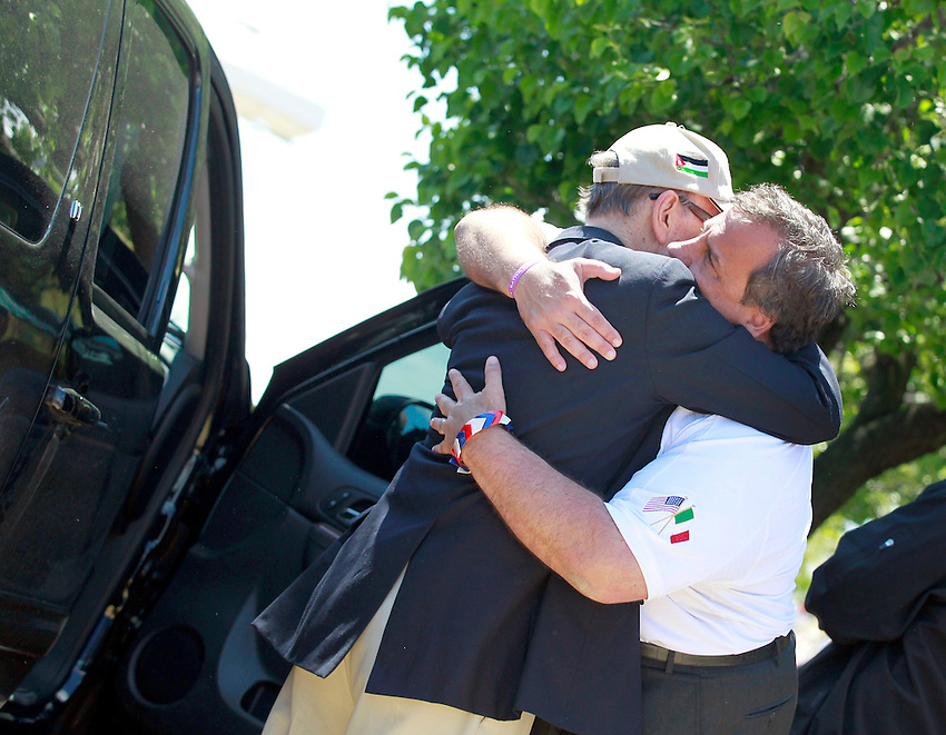 KEANSBURG, NJ - (May 26, 2013) - New Jersey Gov. Chris Christie (right) has a moment with his father, Bill (left), after the governor visits the Keansburg Amusement Park on the Sunday afternoon of Memorial Day weekend. This area suffered extensive damage during Hurricane Sandy.
