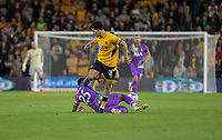 22nd September 2021; Molineux Stadium, Wolverhampton,  West Midlands, England; EFL Cup football, Wolverhampton Wanderers versus Tottenham Hotspur; Japhet Tanganga of Tottenham Hotspurs comes in for a sliding tackle to take the ball from Rayan Ait Nouri of Wolverhampton Wanderers