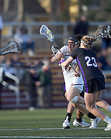 Boston College attacker Brittany Wilton (11) on the attack as University at Albany attacker Kathleen Lennon (23) defends. University at Albany defeated Boston College, 11-10, at Newton Campus Field, on March 30, 2011.