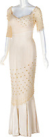 BNPS.co.uk (01202) 558833<br /> Pic: HeritageAuctions/BNPS<br /> <br /> Pictured: Monroe's pearl encrusted mermaid gown from The Prince and the Showgirl (1957) sold for £113,000.<br /> <br /> A selection of Marilyn Monroe memorabilia including some of her famous dresses have sold for £930,000 following a bidding war. ($1.28m)<br /> <br /> The starlet's outfit for the film Bus Stop (1956), a black lace over green mesh top and black silk wraparound skirt, fetched £290,000. The ensemble was lent to Madonna in 1991 for a Vanity Fair photo shoot.<br /> <br /> Her silk polka-dot dress from The Seven Year Itch (1955), which had a label with 'M.Monroe' handwritten on it, went for £154,000.<br /> <br /> Monroe's pearl encrusted mermaid gown from The Prince and the Showgirl (1957) sold for £113,000, while her heavily annotated script for The Seven Year Itch fetched £59,000.<br /> <br /> The memorabilia went under the hammer with Heritage Auctions, of Dallas, Texas, who said the prices achieved showed her 'enduring popularity' with collectors 59 years after her death.