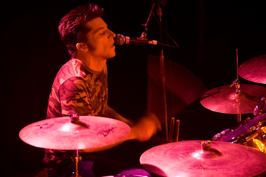 Drummer Anthony Burulcich wails on the symbol during a performance at Toad's Place
