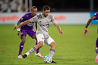 LAKE BUENA VISTA, FL - JULY 25: Jorge Corrales #26 of the Montreal Impact kicks the ball during a game between Montreal Impact and Orlando City SC at ESPN Wide World of Sports on July 25, 2020 in Lake Buena Vista, Florida.