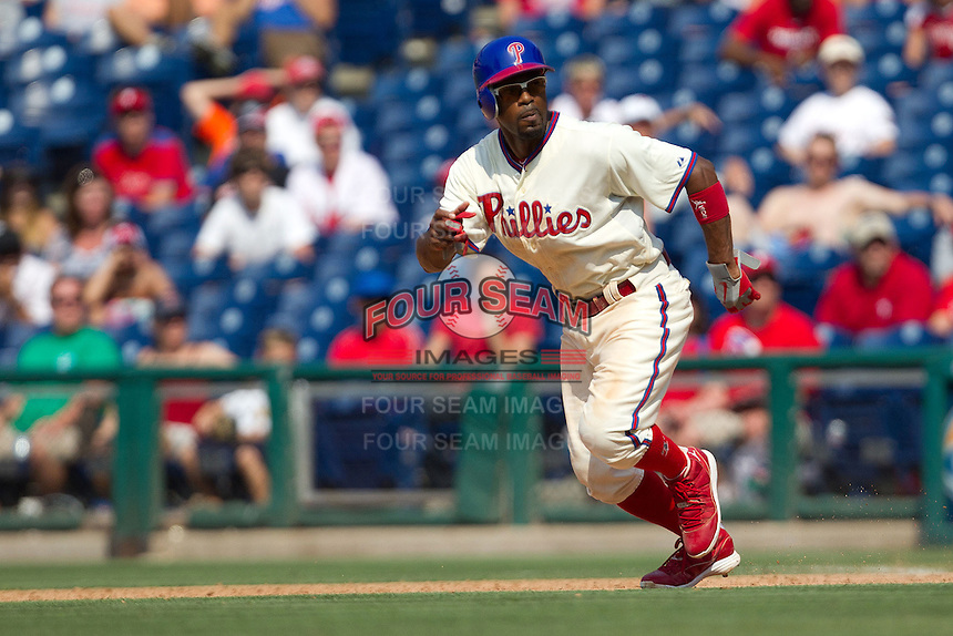 Philadelphia Phillies shortstop Jimmy Rollins #11 attempts a steal during the Major League Baseball game against the Pittsburgh Pirates on June 28, 2012 at Citizens Bank Park in Philadelphia, Pennsylvania. The Pirates defeated the Phillies 5-4. (Andrew Woolley/Four Seam Images).