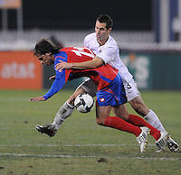USMNT defender Carlos Bocanegra (3) fouls Costa Rica forward Bryan Ruiz (11)   The USMNT tied Costa Rica 2-2 on the final game of the 2010  FIFA World Cup Qualifying round at RFK Stadium,Wednesday  October 14 , 2009.