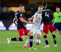 WASHINGTON, DC - MAY 13: Frederic Brillant #13 of D.C. United clears the ball during a game between Chicago Fire FC and D.C. United at Audi FIeld on May 13, 2021 in Washington, DC.