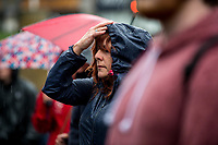 Monday 05 June 2017<br /> Pictured: People stand in the rain during the vigil <br /> Re: A vigil has been held in Swansea City Centre to remember the victims of the recent terror attack in London. Stand up to Racism Swansea have organised the event alongside Swansea Coalition Against War and Swansea People's Assembly.