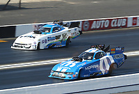 Feb 8, 2020; Pomona, CA, USA; NHRA funny car driver Matt Hagan (near) races alongside John Force during qualifying for the Winternationals at Auto Club Raceway at Pomona. Mandatory Credit: Mark J. Rebilas-USA TODAY Sports