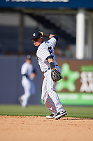 New York Yankees shortstop Diego Castillo (83) throws to first base during a Grapefruit League Spring Training game against the Toronto Blue Jays on February 25, 2019 at George M. Steinbrenner Field in Tampa, Florida.  Yankees defeated the Blue Jays 3-0.  (Mike Janes/Four Seam Images)
