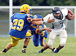 Seymour, CT-06 September 2012-090611CM08-  Oxford's Brandon Diaz (7) pushes off Seymour's Julian Falcioni  during a scrimmage against Oxford Thursday night in Seymour.    Christopher Massa Republican-American
