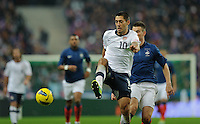 Clint Demspey of team USA and Laurent Koscielny of France fight for the ball during the friendly match France against USA at the Stade de France in Paris, France on November 11th, 2011.