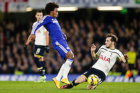 03.12.2014.  London, England. Premier League. Chelsea versus Tottenham Hotspur.  Chelsea's Willian tackled by Tottenham Hotspur's Ryan Mason ; Mason was made interim team manager for 2021 season after Spurs sacked Jose Mourinho. Mason retired from playing for Tottenham after suffering a fractured skull in a game in early 2017 at Hull.