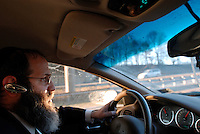 Rabbi Avrohom Stone driving from New Jersey into Pennsylvania to make an unannounced visit to one of his businesses. Rabbi Stone has 72 Kosher businesses on his books. He has to keep an inventory of all ingredients used by all 72 businesses, he has to check that they are all Kosher, and he must make announced and unannounced visits to check that things are running satisfactorily.