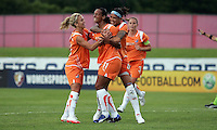 Sky Blue's Kacey White (20) and Natasha Kai (6) hug teammate Rosana (11) after she scores in the first half.  Sky Blue defeated the Chicago Red Stars 1-0 in a mid-week game, Wednesday, June 17, at Yurcak Field.
