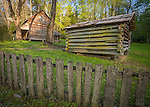 "Great Smoky Mts. National Park, TN/NC<br /> Farm house smoke house and weathered wood fence at ""The Tipton place"" farm site in Cades Cove"