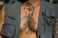NEW YORK, USA - May 25: A Black Lives Matter supporter's tattoo is seen in Cadman Plaza Park on the first anniversary of death on May 25, 2021 in New York City. George Floyd's assassination in Minneapolis sparked a worldwide outcry and continued to propel the Black Lives Matter movement through different cities in the United States and the world. (Photo by Pablo Monsalve / VIEWpress via Getty Images)