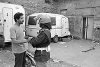 """- Milano, settembre 1990, sgombero della """"Cascina  Rosa"""", antica struttura agricola fatiscente alla periferia est della città occupata abusivamente da immigrati nordafricani<br /> <br /> - Milan, September 1990, evacuation of the """"Cascina Rosa"""", an ancient dilapidated agricultural structure on the eastern outskirts of the city illegally occupied by North African immigrants."""