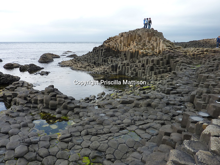 County Antrim, Northern Ireland - July 14, 2010:  Basalt columns of varying heights interlock at the Giant's Causeway.