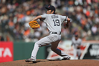 SAN FRANCISCO, CA - AUGUST 21:  Koji Uehara #19 of the Boston Red Sox pitches against the San Francisco Giants during the game at AT&T Park on Wednesday, August 21, 2013 in San Francisco, California. Photo by Brad Mangin