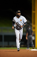 Mesa Solar Sox right fielder Jo Adell (25), of the Los Angeles Angels organization, jogs off the field between innings of an Arizona Fall League game against the Salt River Rafters on September 19, 2019 at Salt River Fields at Talking Stick in Scottsdale, Arizona. Salt River defeated Mesa 4-1. (Zachary Lucy/Four Seam Images)