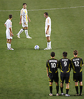 LA Galaxy's Peter Vagenas (8-L), Kevin Harmse (6-C) and Chris Klein (7-R) ponder a free kick in front of a three man wall consisting of Columbus Crew's Alejandro Moreno (10-L), Jason Garey (9-C) and Eddie Gaven (12-R). The Columbus Crew beat the LA Galaxy 3-2 at the Home Depot Center in Carson, California, Saturday, June 23, 2007.