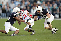 State College, PA -- 10/13/2007 -- Safety Tony Davis (11) and linebacker Dan Connor (40) tackle quarterback Tyler Donovan.  The Penn State defense sacked Donovan five times during the game.  Penn State defeated Wisconsin by a score of 38-7 on Saturday, October 13, 2007, at Beaver Stadium.    ..Photo:  Joe Rokita / JoeRokita.com