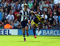 Pictured L-R: Jonas Olsson of West Brom pushes away Wayne Routledge of Swansea. Sunday 01 September 2013<br /> Re: Barclay's Premier League, West Bromwich Albion v Swansea City FC at The Hawthorns, Birmingham, UK.