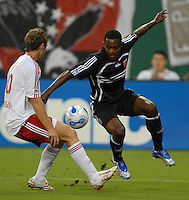 DC United forward Luciano Emilio (11) tries to get control of the ball against New York Red Bulls defender Jeff Parke (60). DC United defeated the New York Red Bulls 3-1, at RFK Stadium in Washington DC, Thursday August  22, 2007.