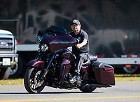 Sep 15, 2019; Mohnton, PA, USA; NHRA top fuel driver Mike Salinas rides a Harley Davidson motorcycle during the Reading Nationals at Maple Grove Raceway. Mandatory Credit: Mark J. Rebilas-USA TODAY Sports