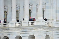 Washington, DC - January 6, 2021: People are seen on the balcony of the U.S. Capitol as thousands of protesters in support of President Donald Trump surround the U.S. Capitol building January 6, 2021 as Congress was in session to accept the electors of the November 3 presidential election.  (Photo by Don Baxter/Media Images International)