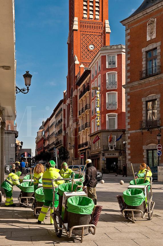 Crews of Limpieza, street cleaning service workers keep the city clean, Madrid, Spain