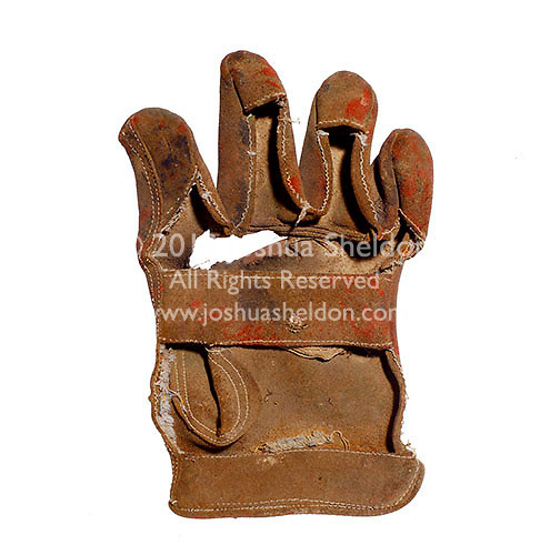 Torn leather glove<br />