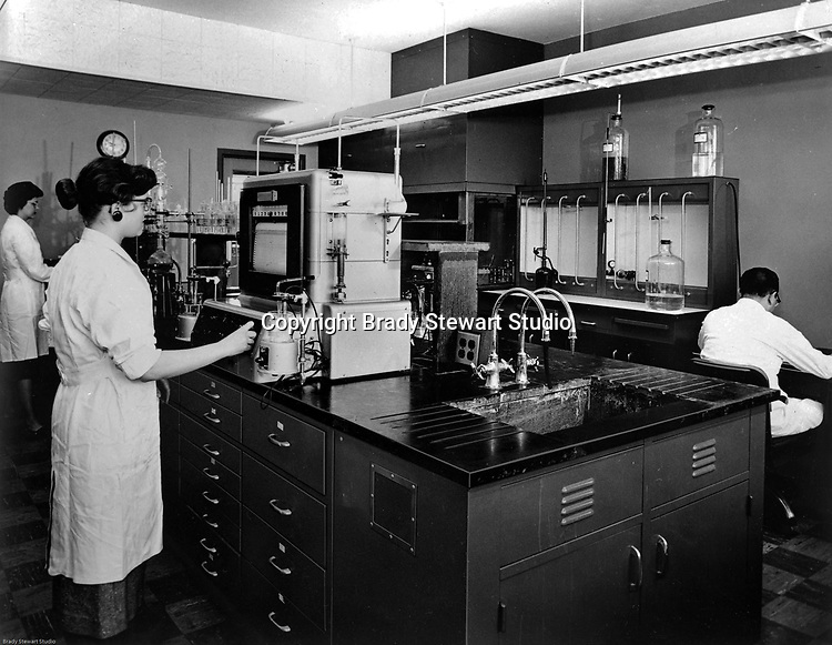 Client: Calgon<br /> Ad Agency: William W Mathews Company<br /> Product: Calgon Water Treatment Systems<br /> Location: HK Porter Building in Pittsburgh<br /> <br /> View of Calgon chemists and technicians testing water treatment systems in the HK Porter Building laboratory.