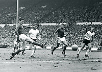 July 30th 1966, World Cup Final- Wembley Stadium, London, England. Martin Peters of England scores for 2-1 watched by Wolfgang Weber (Ger), Roger Hunt England and Horst-Dieter Höttges (ger)